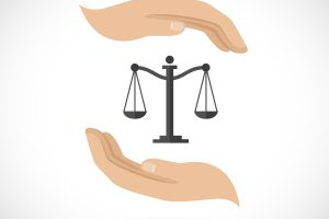Hands hold and protect scales of justice and law concept vector illustration